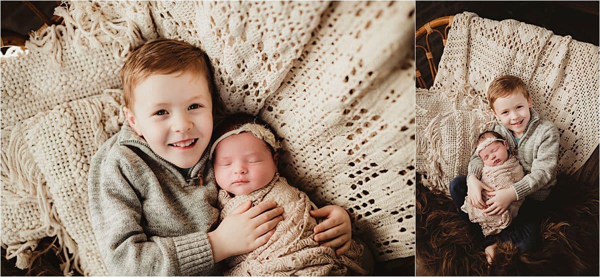 Brother Snuggling Newborn Sister