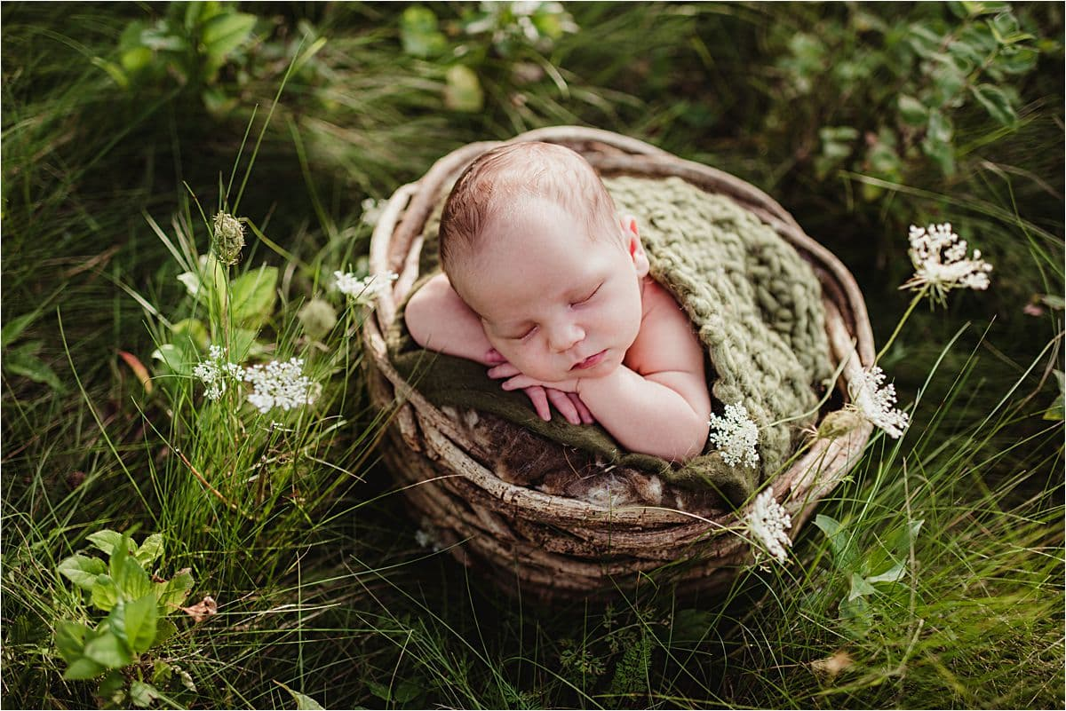 Newborn in Green Blanket