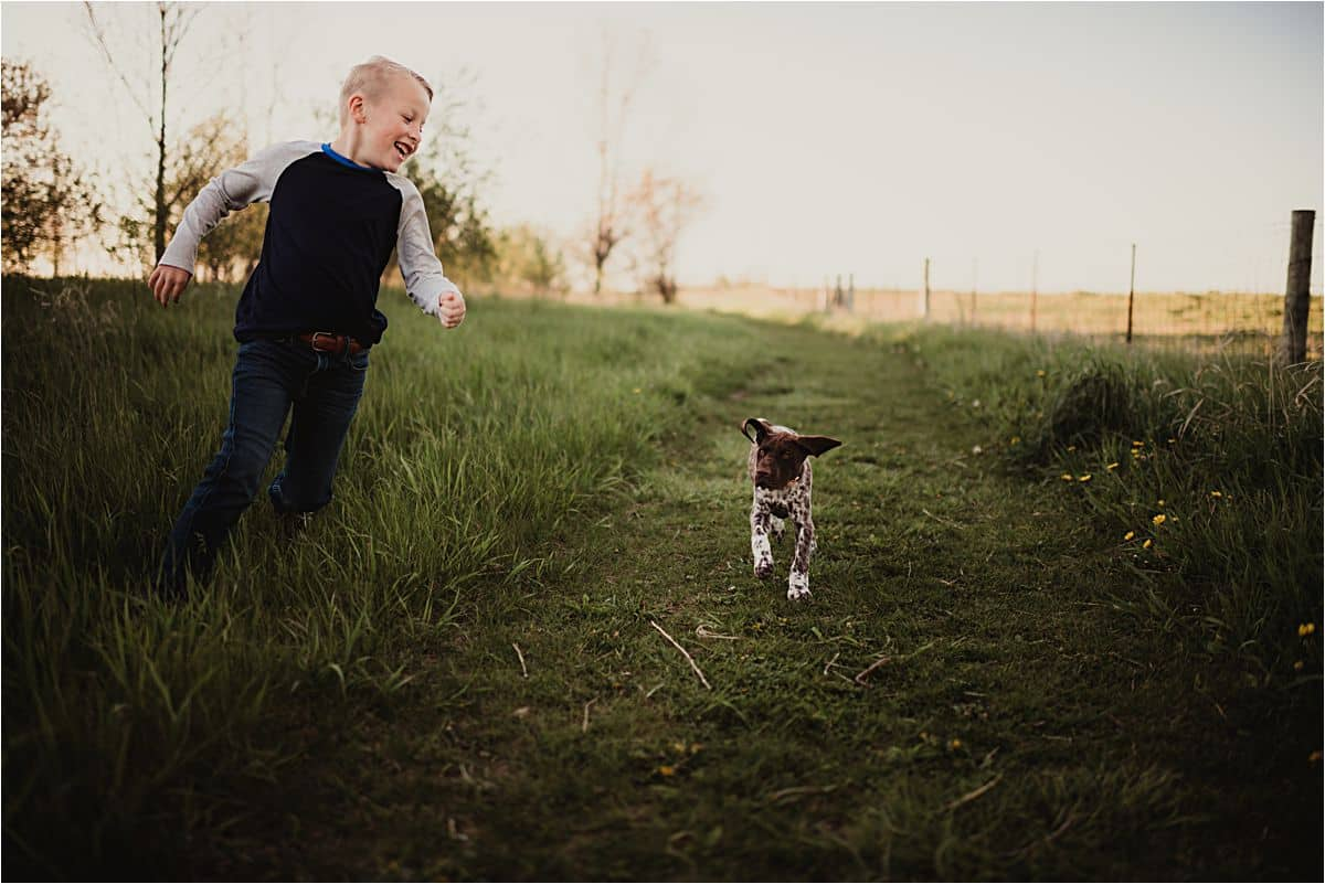 Boy Running with Dog