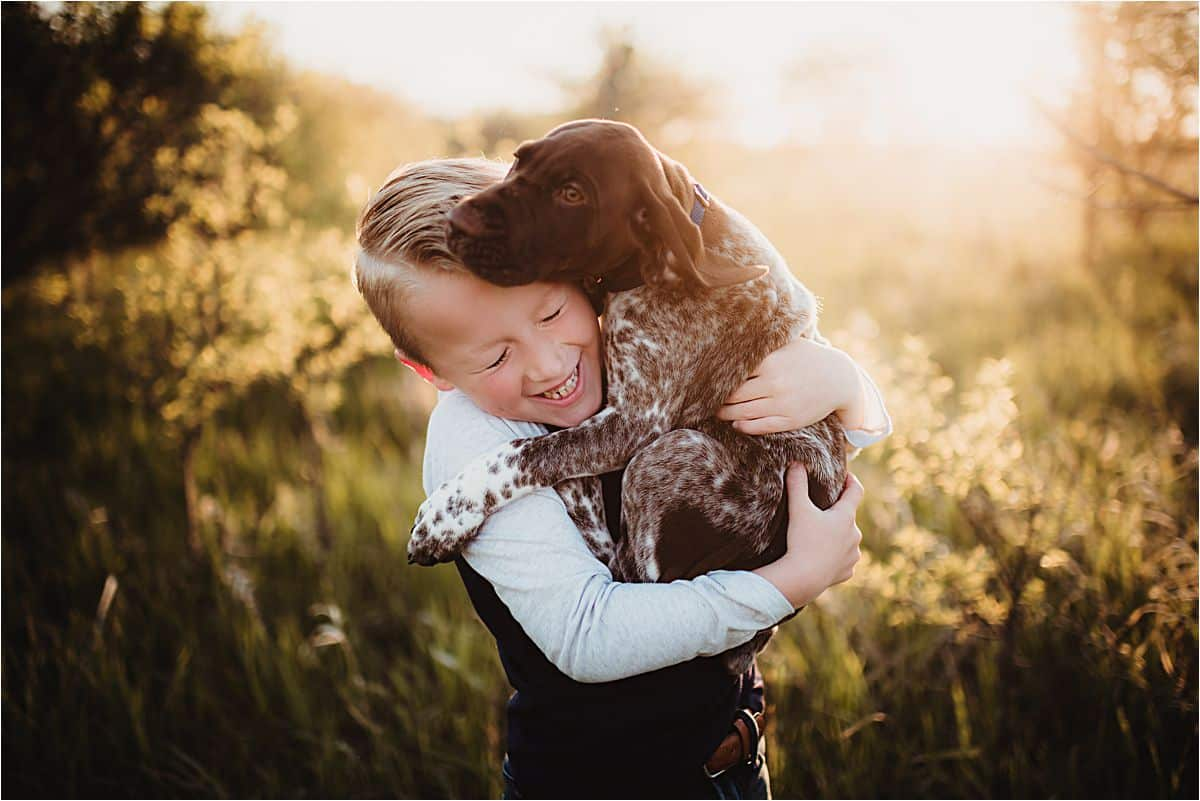 Boy Holding Dog Laughing