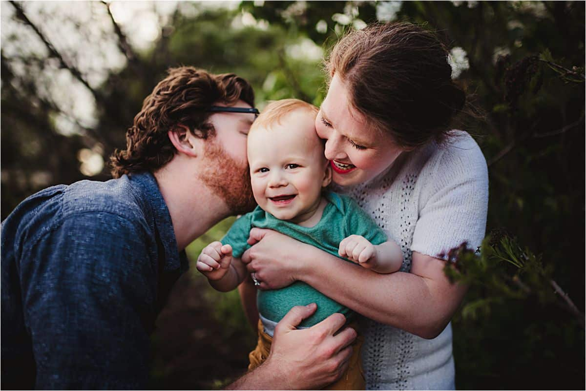 Sunset Spring Family Session Parents Snuggling Son