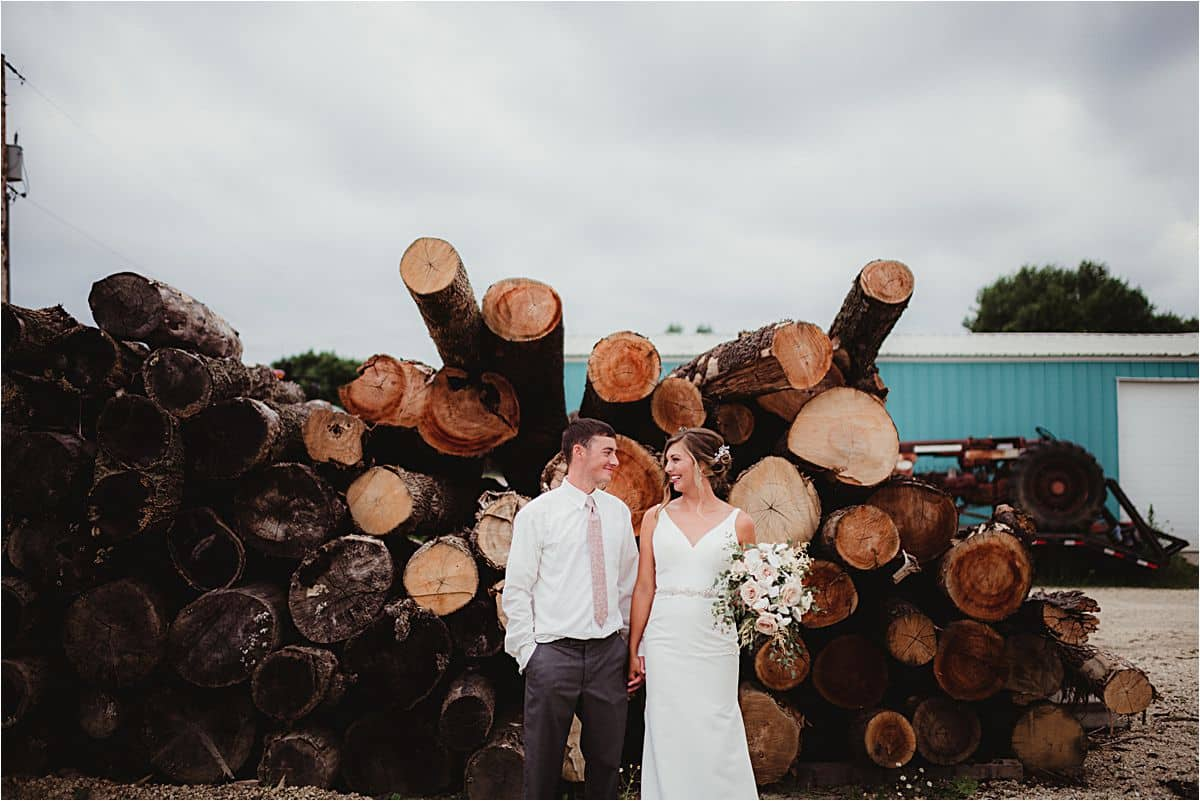Couple by Wood Pile