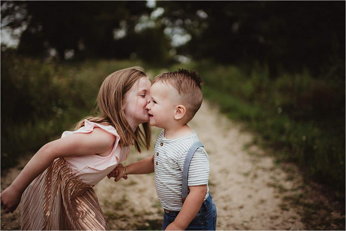 Sister Kissing Brother on Cheek