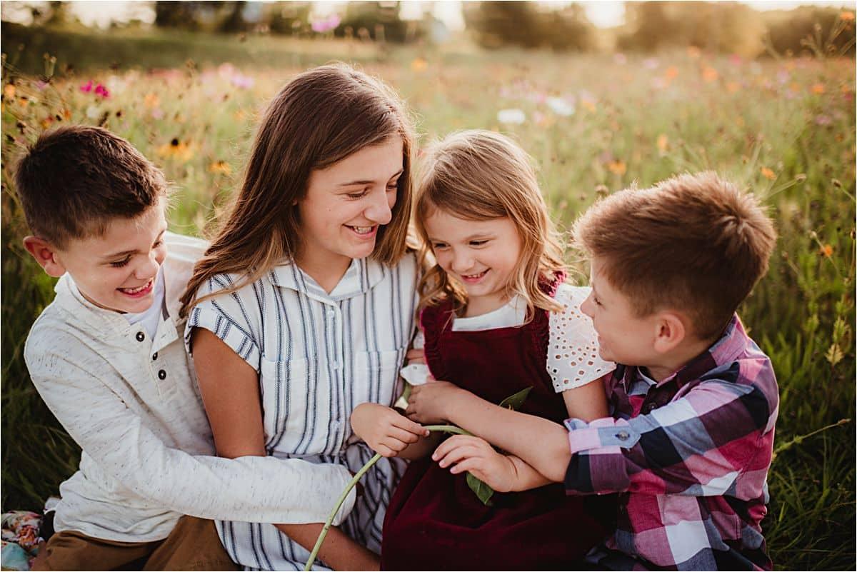 Siblings Hugging in Field