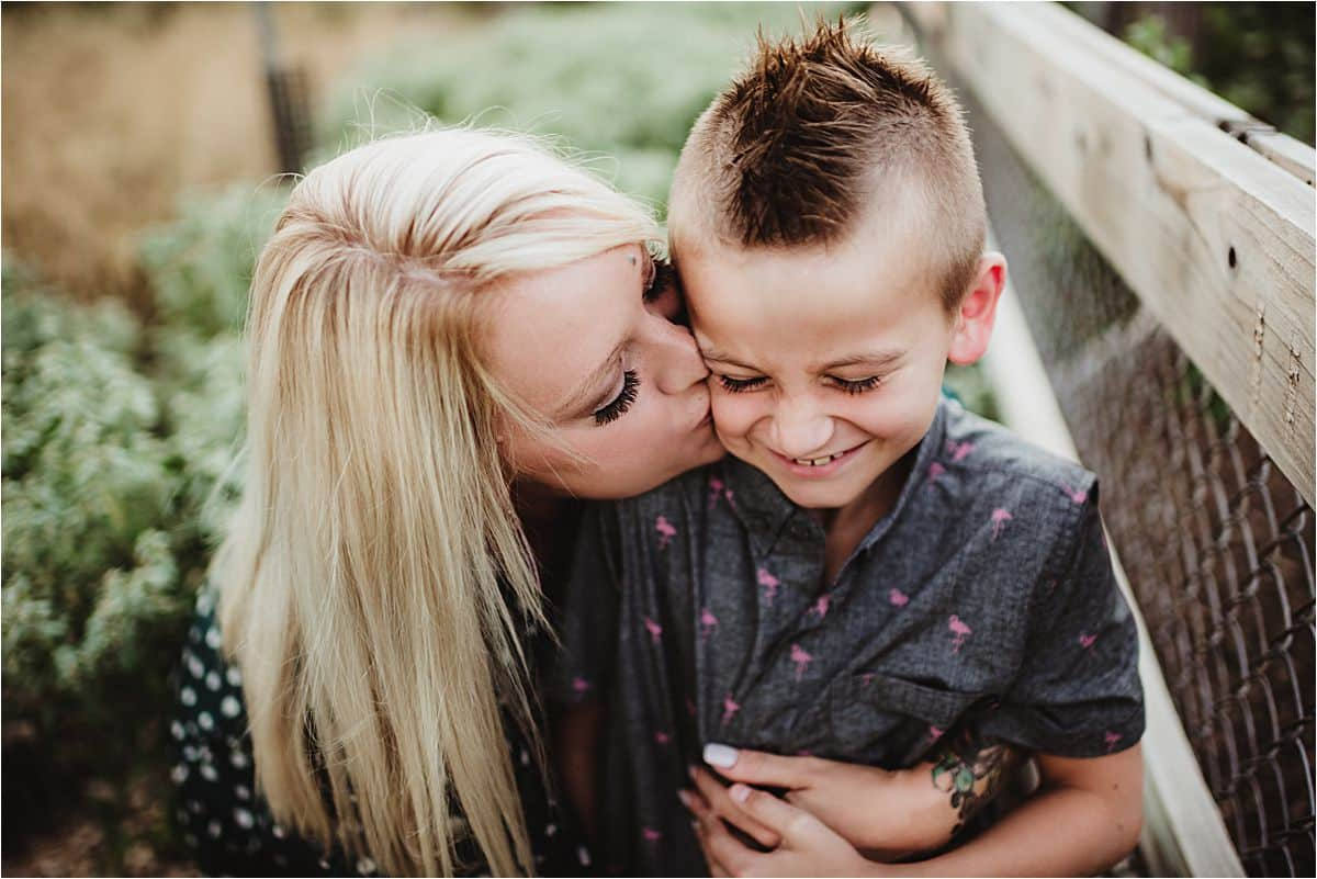 Woodland Family Adventure Session Mama Kissing Son's Cheek