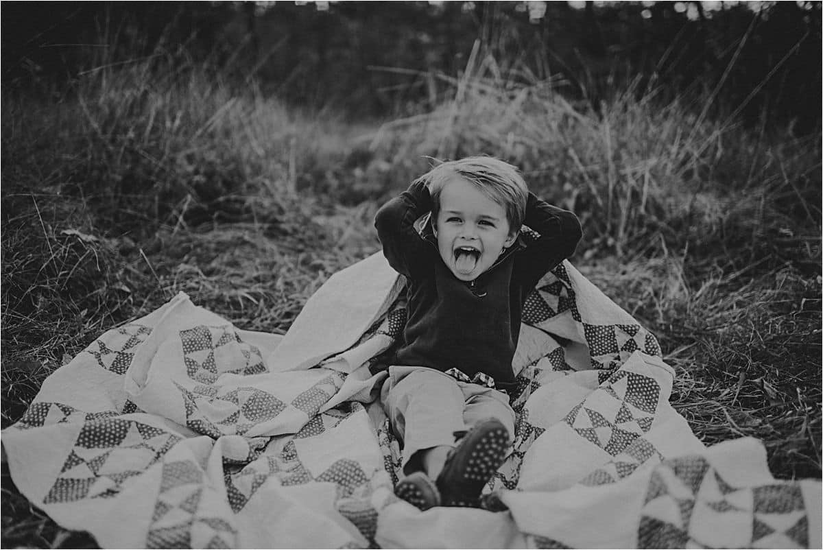 Boy Being Silly on Quilt