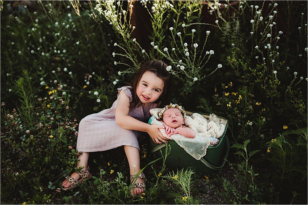 Urban Wildflower Newborn Session Big Sister with Newborn in Field