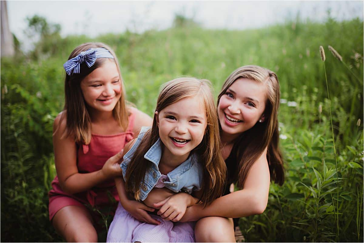 Sunset Summer Family Session Sisters Hugging