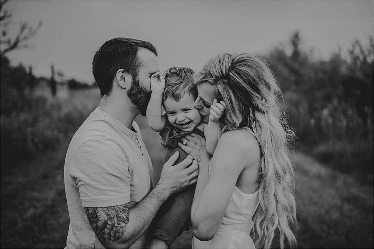 Boho Summer Family Session Parents Kissing Son