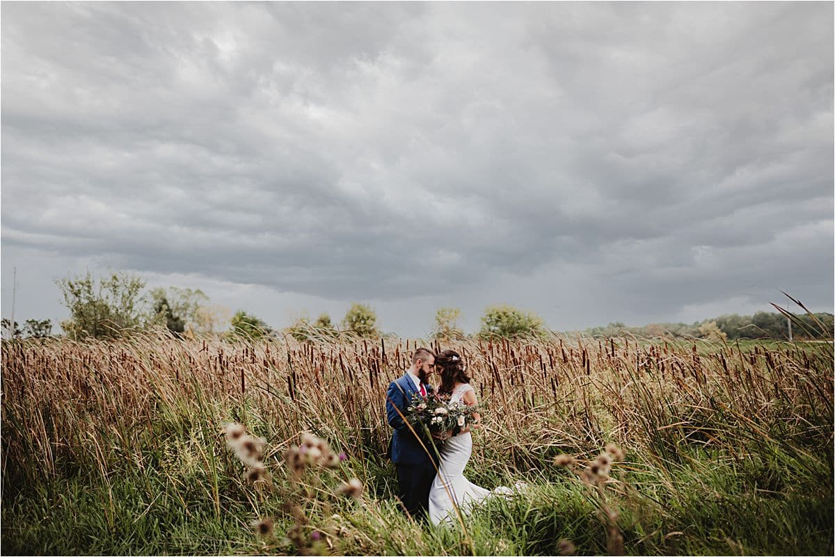 Romantic Rustic Wedding Bride Groom in Field