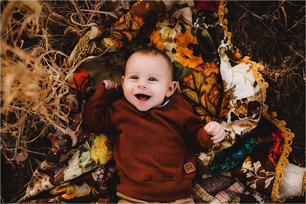 Late Fall Sunset Family Session Baby on Blanket Smiling