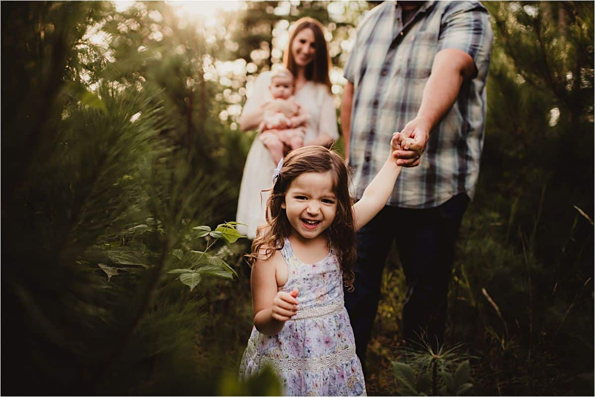 Little Girl Leading Family