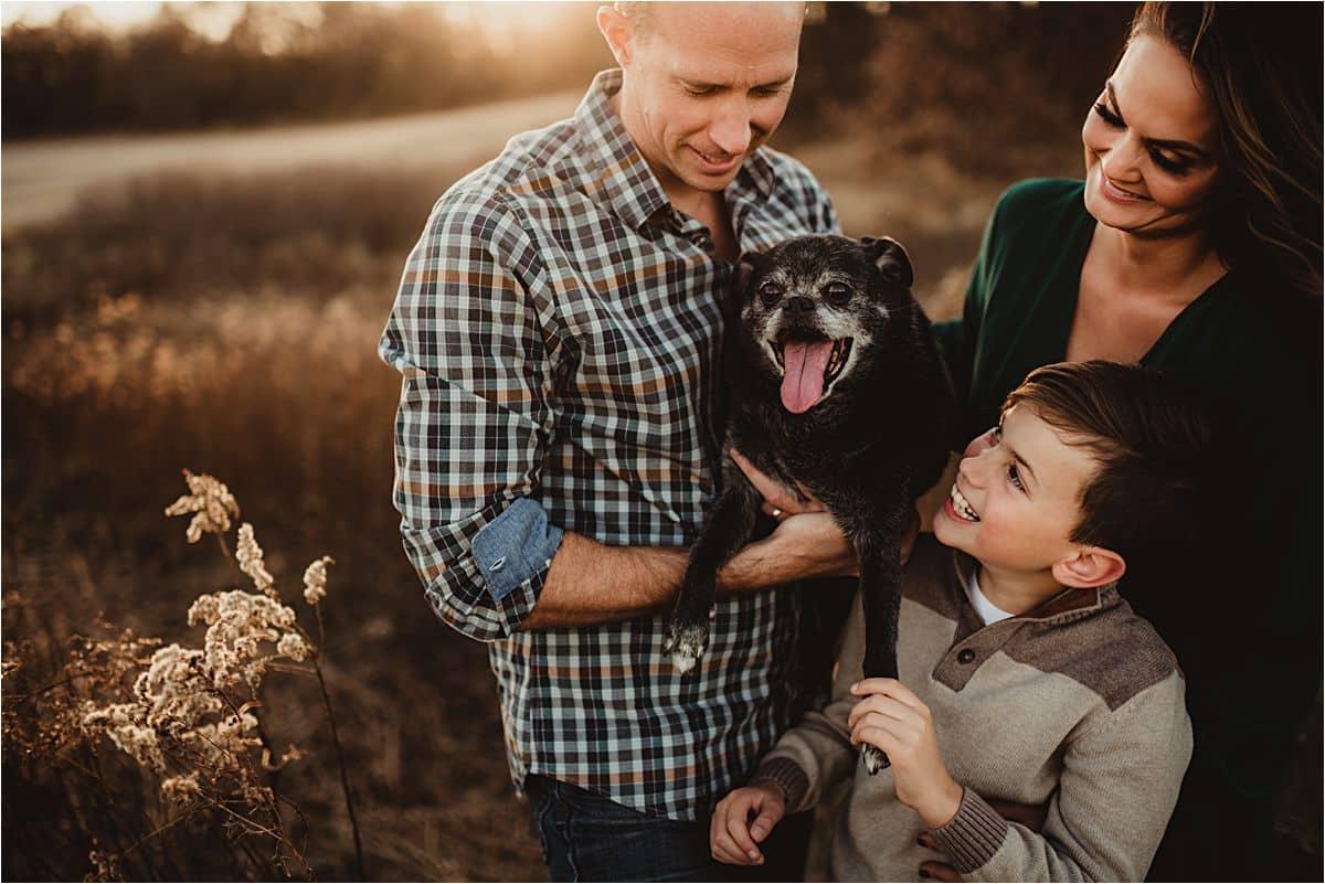 Family Holding Dog