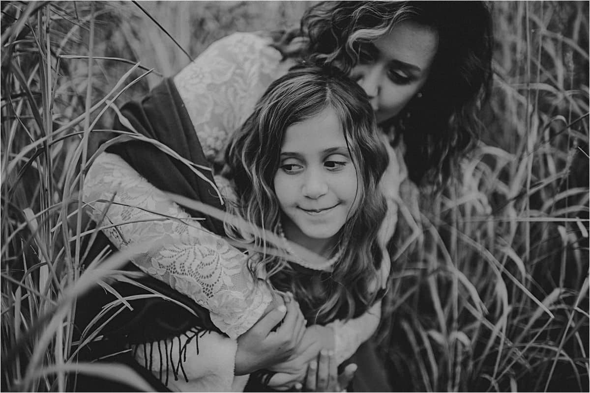 Black and White Image Mom Hugging Daughter