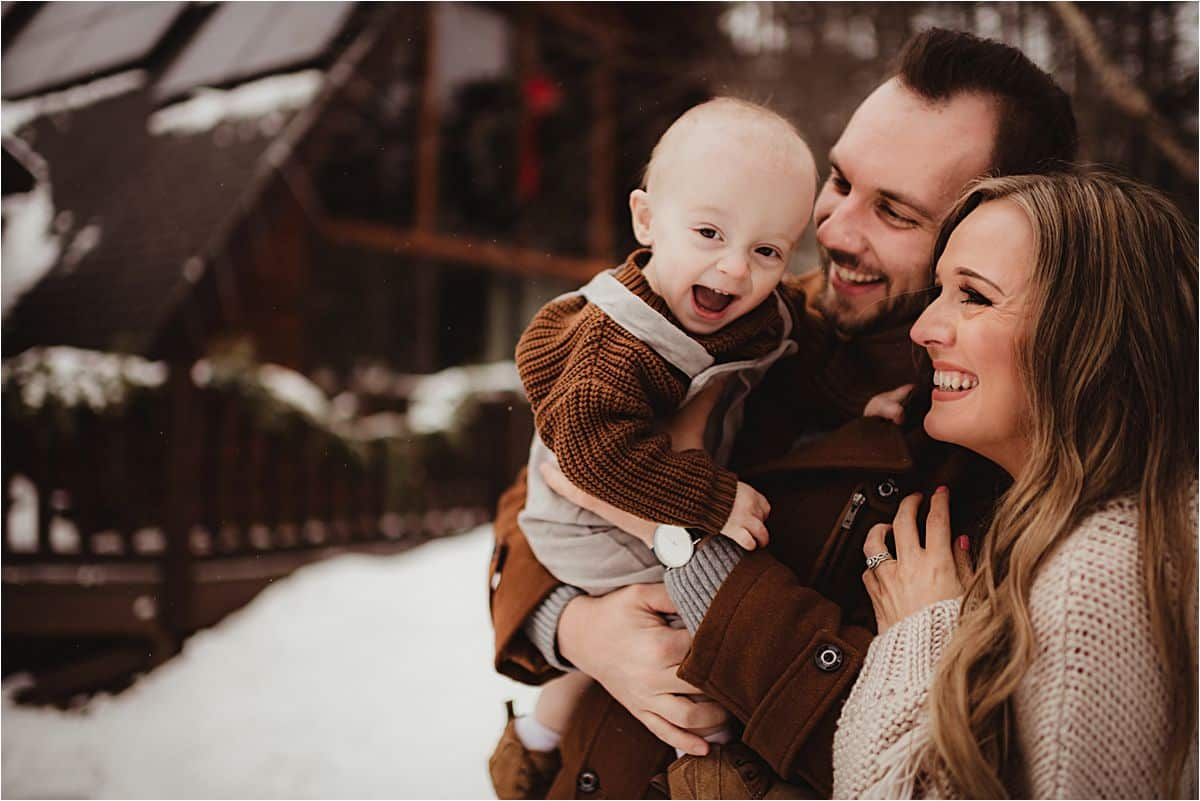 Parents Holding Smiling Baby