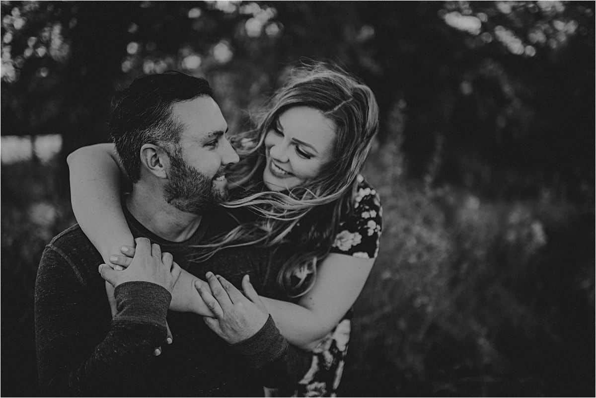 October Sunset Engagement Session Couple Snuggling