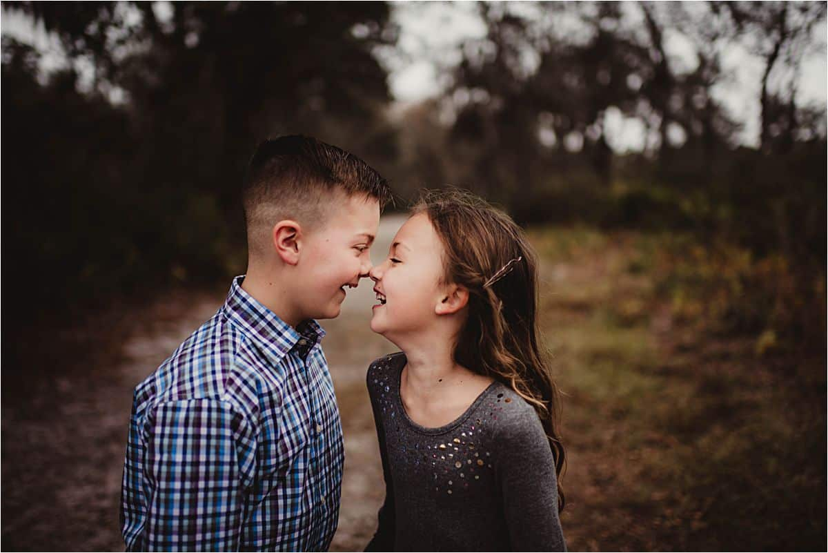 Florida Forest Family Session Siblings Touching Noses
