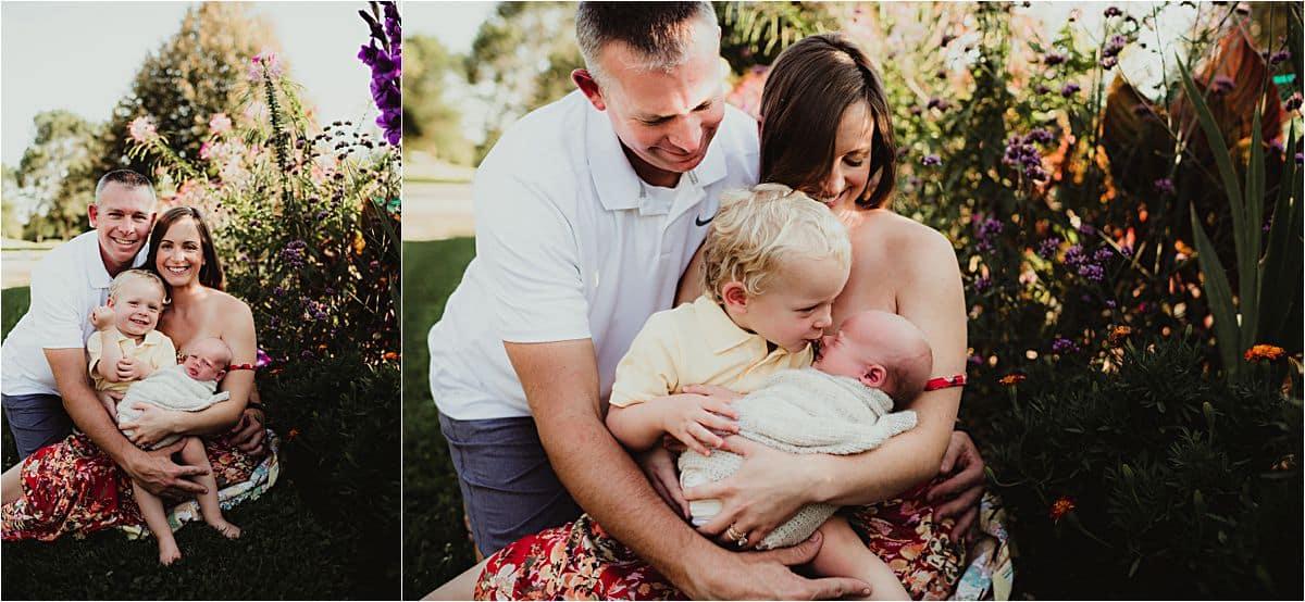 Summer Garden Family Session Family Snuggling Newborn