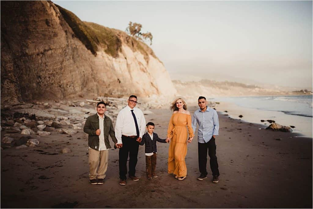 Coastal Golden Hour Session Family Holding Hands on Beach