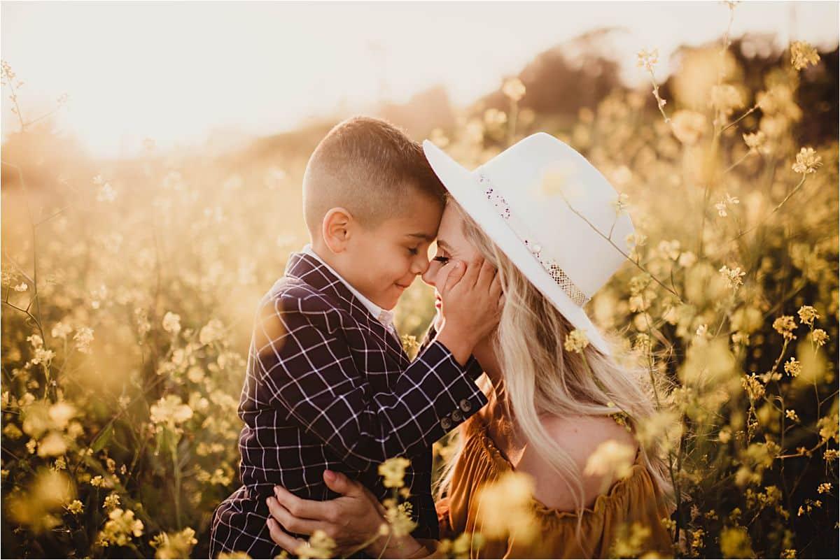 Little Boy Holding Moms Face