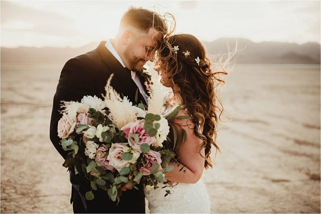 Windblown Desert Spring Wedding Couple Touching Foreheads