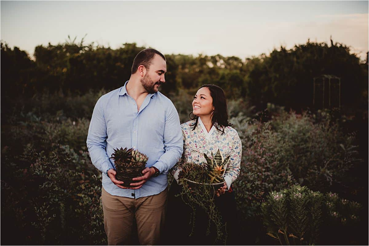 Couple Holding Plants