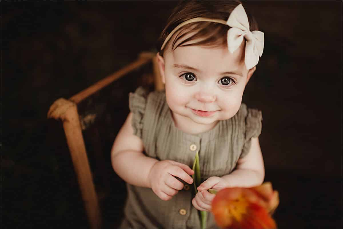 Close Up Baby Girl with Flower