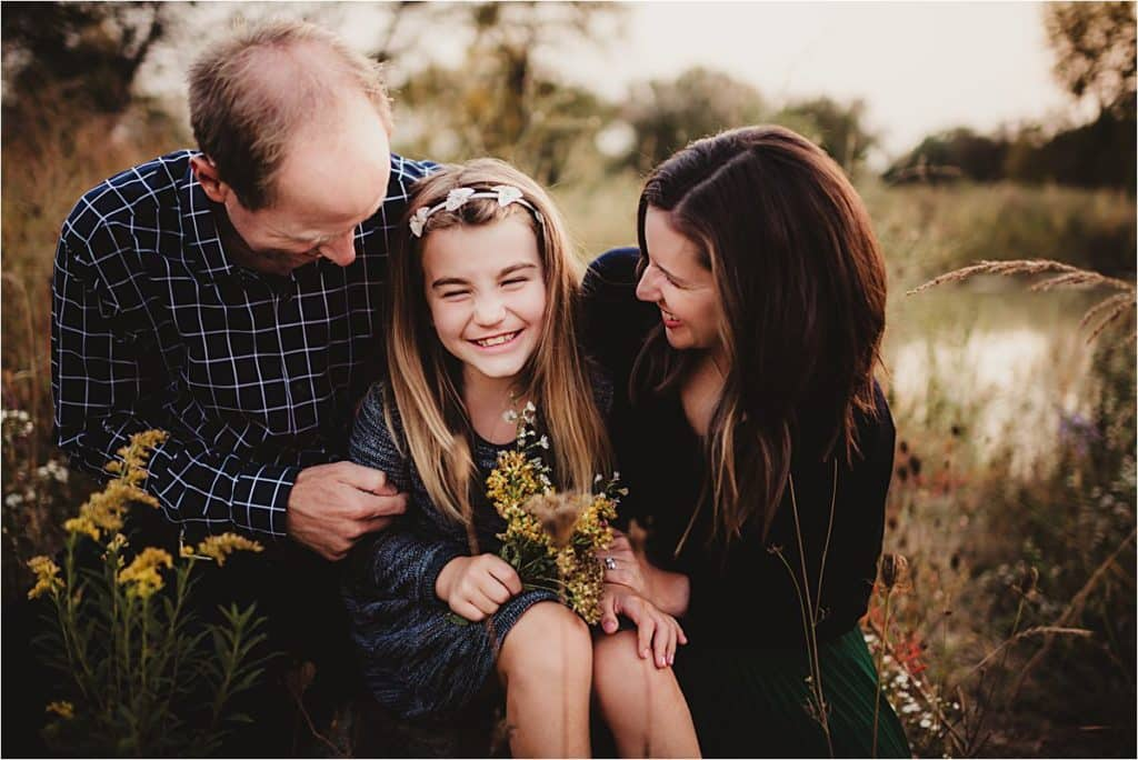 Summer Family Wildflower Session Parents Tickling Daughter