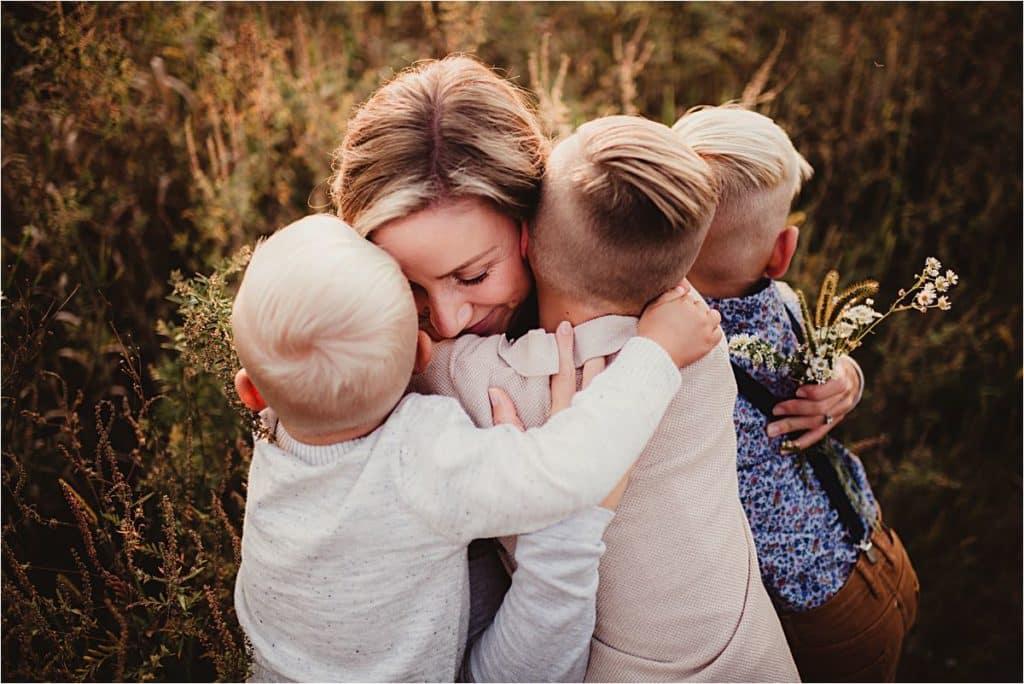 Mama Hugging Boys