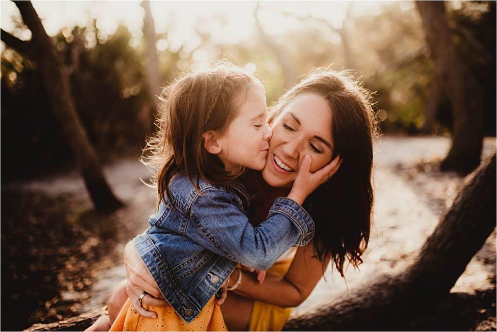 Girl Kissing Mom's Cheek