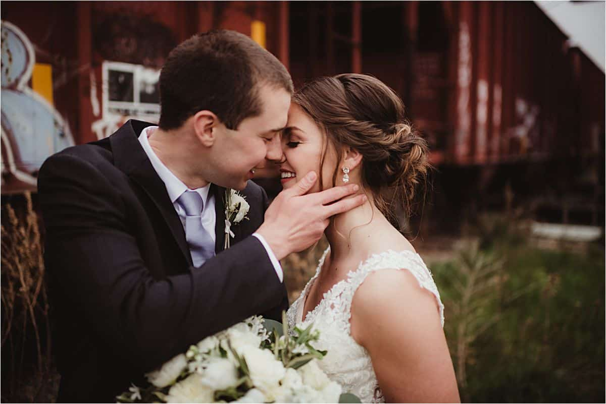 Close Up Groom Holding Bride's Face