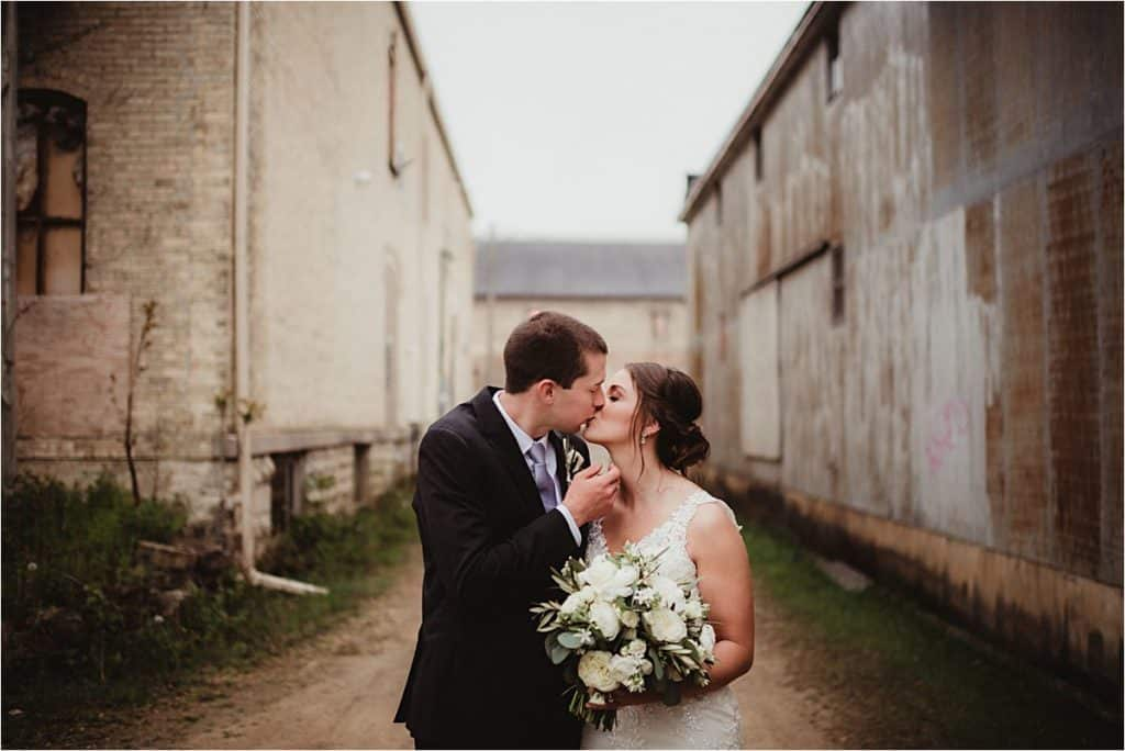 White Florals Spring Wedding Bride Groom Kissing