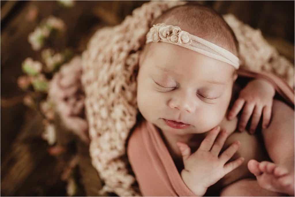 Close Up Newborn Girl in Pink