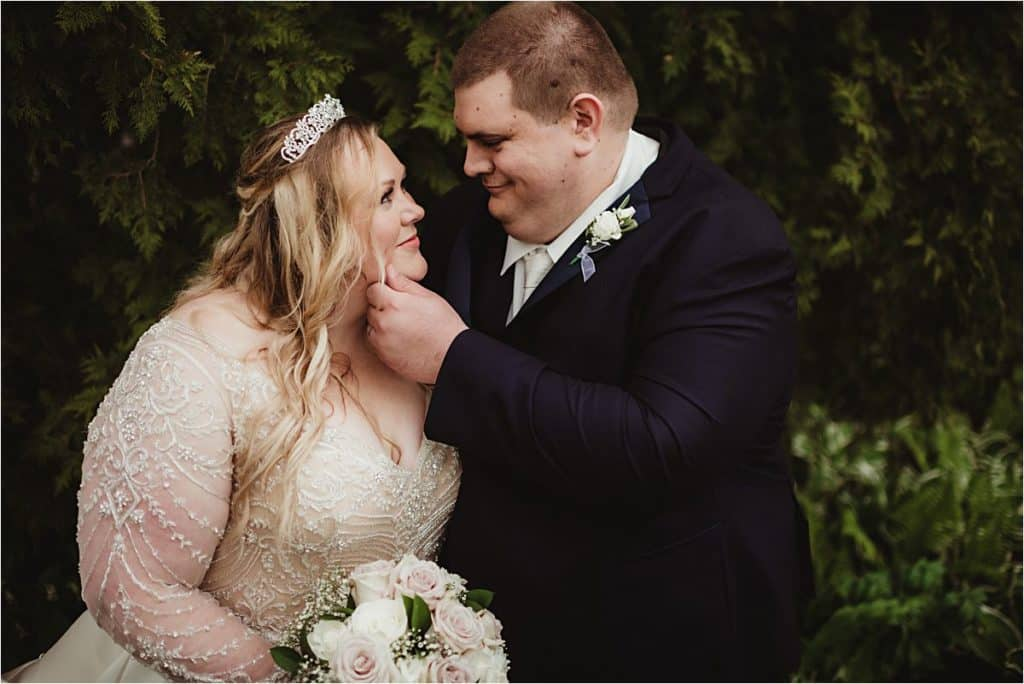 Groom Touching Bride's Face