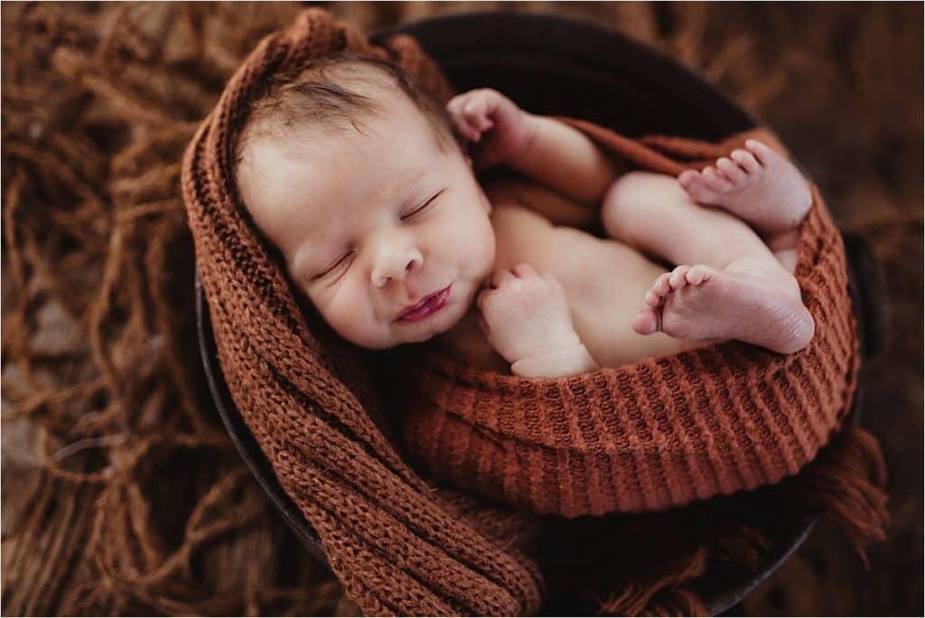 Rustic Neutral Newborn Session Boy in Rust Wrap