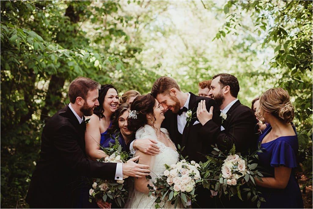 Wedding Party Surrounding Bride Groom