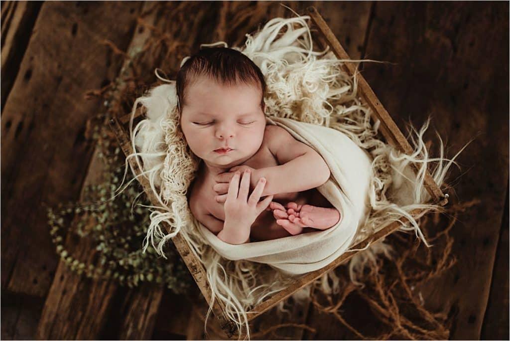 Newborn Boy Portrait Session Boy in Crate