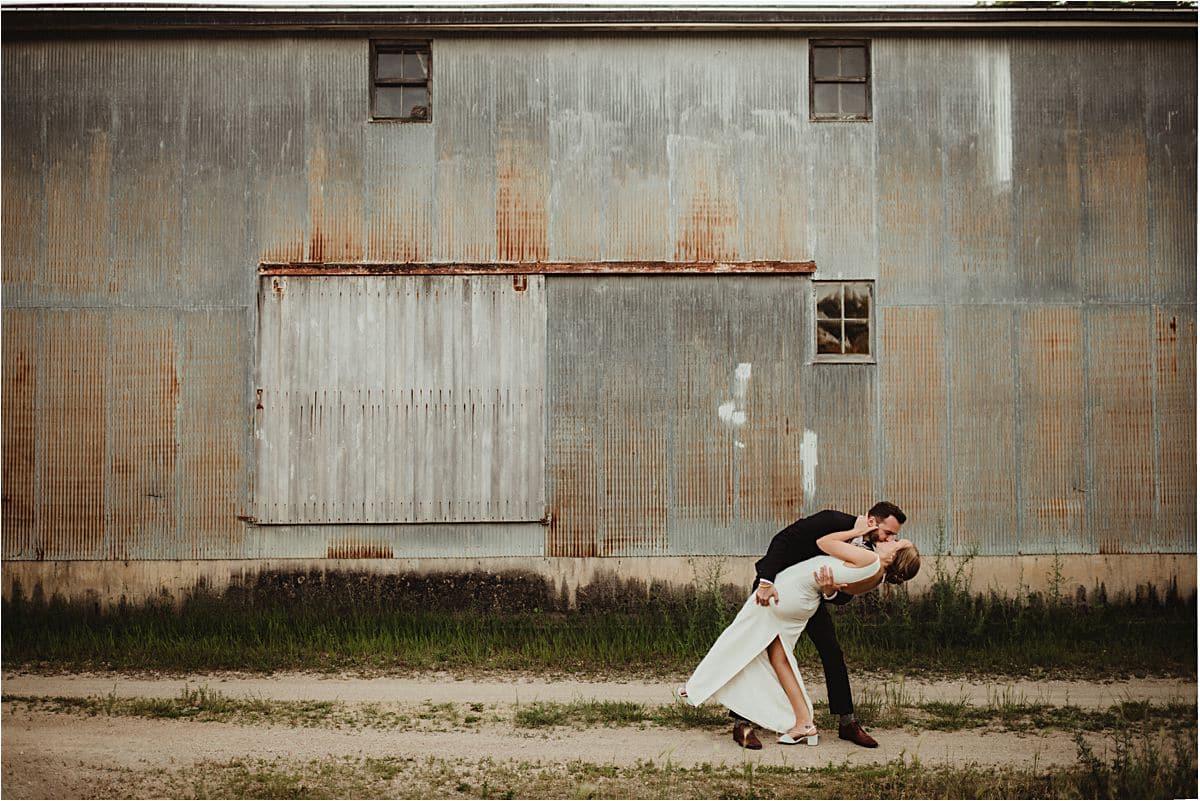 Groom Dipping Kissing Bride