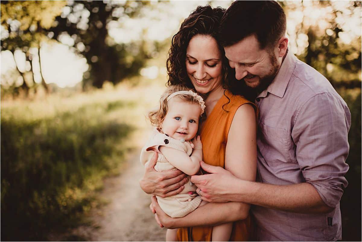 Family Snuggling Little Girl