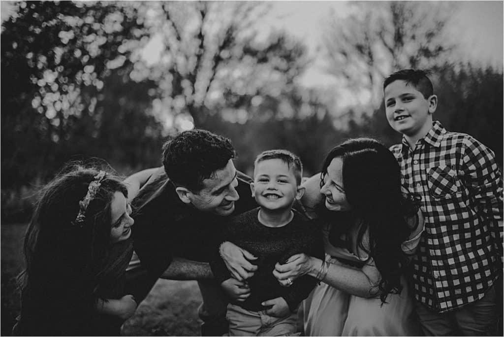 Family Hugging Little Boy