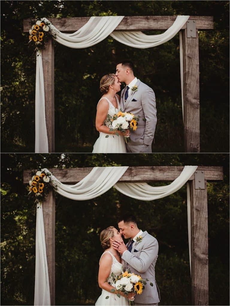 Modern Barn Wedding Couple Under Arch