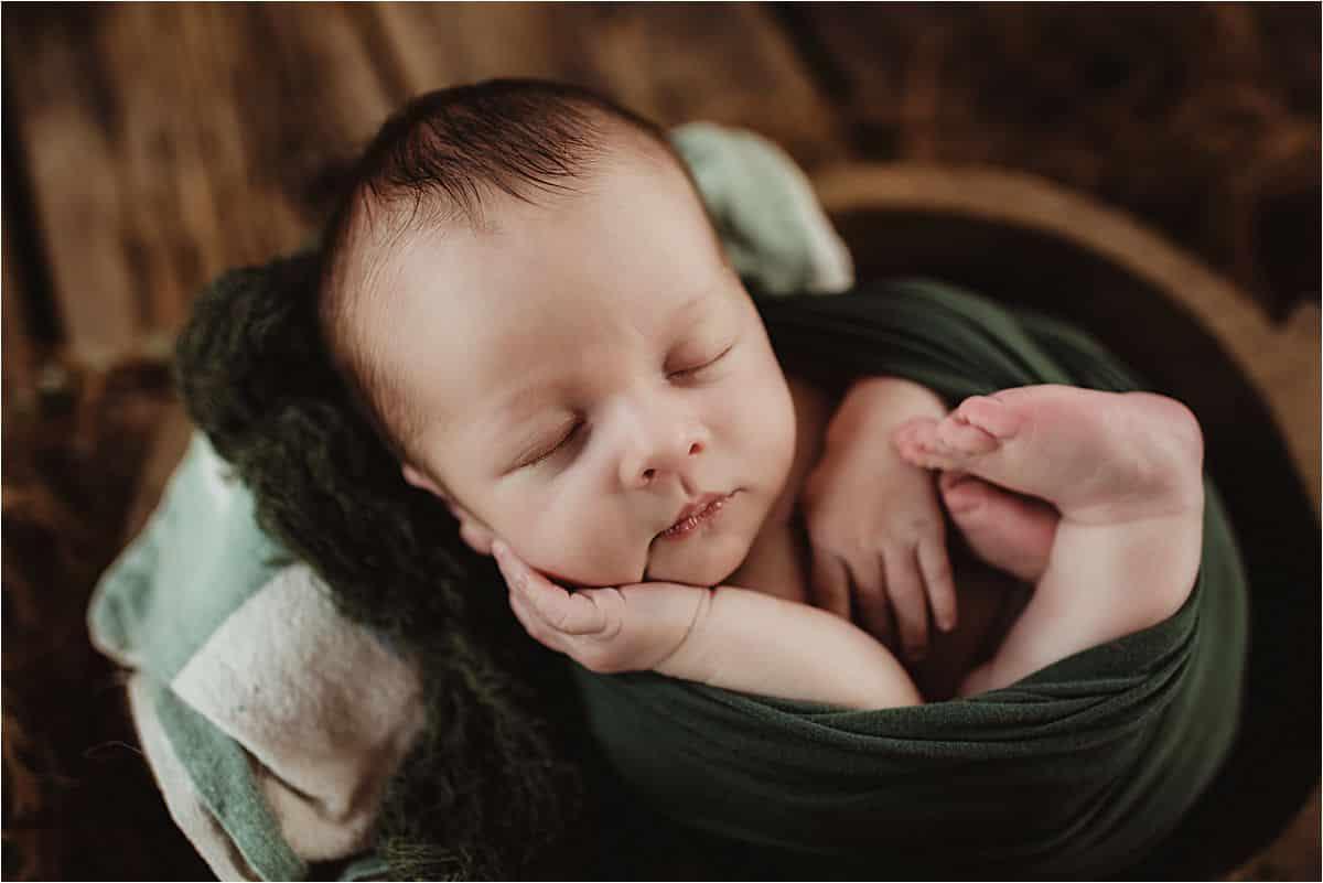 Newborn Boy in Green Wrap
