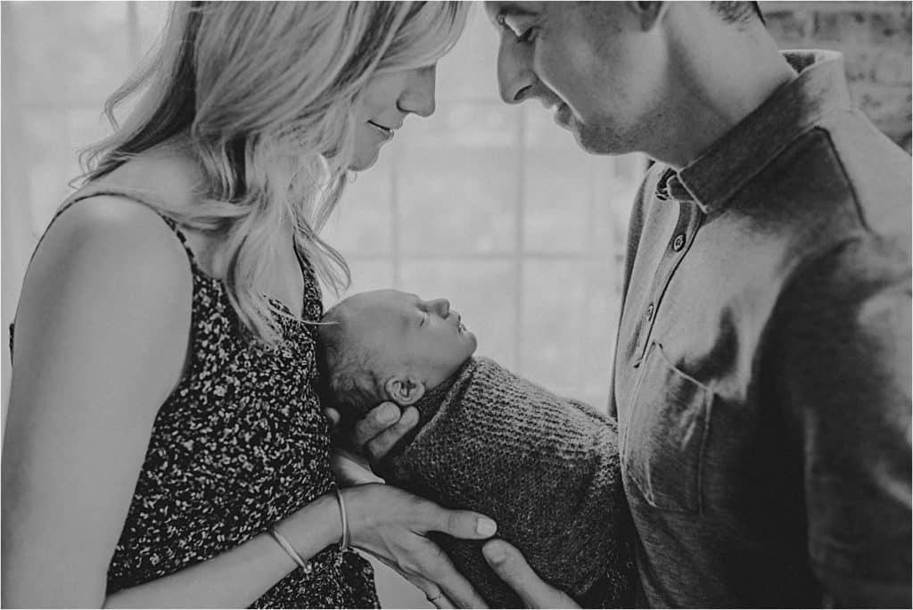 Summer Studio Newborn Session Parents Holding Newborn Boy