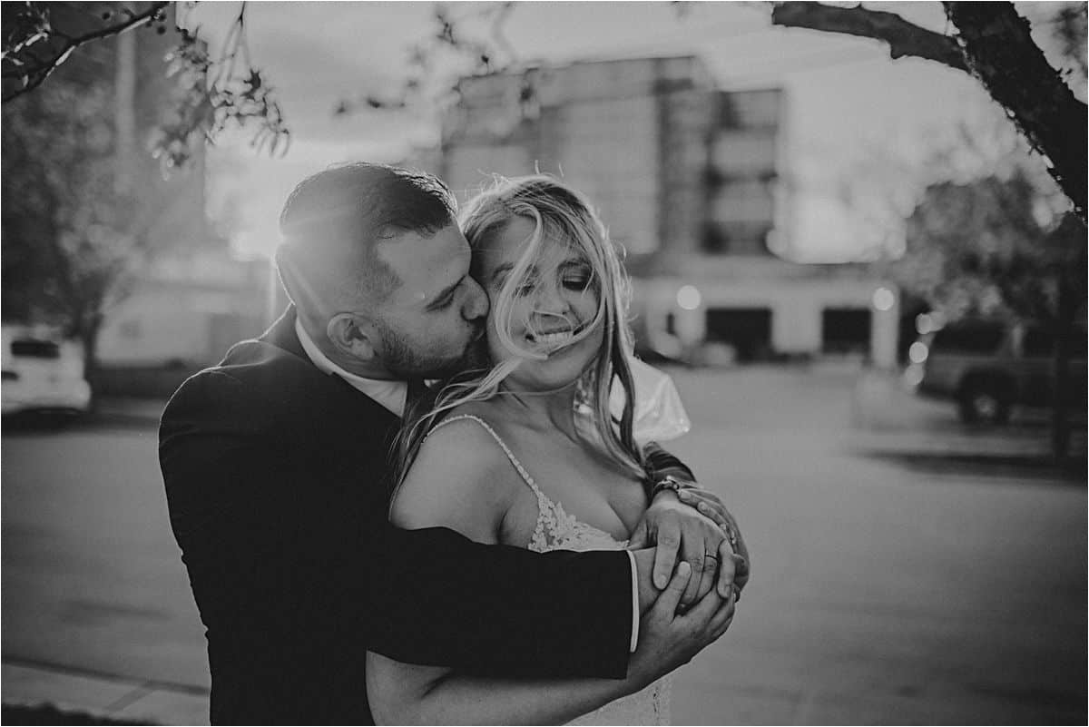 Black White Groom Hugging Bride