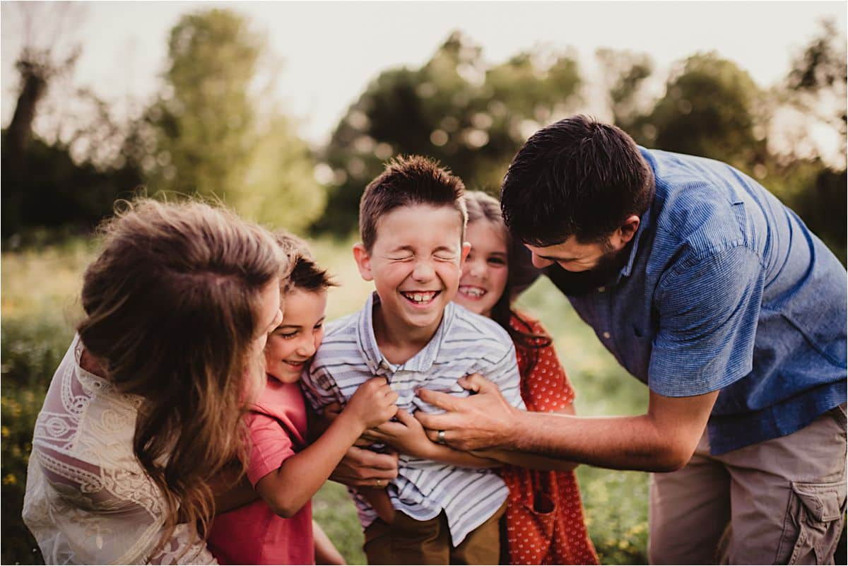 Family Making Boy Laugh