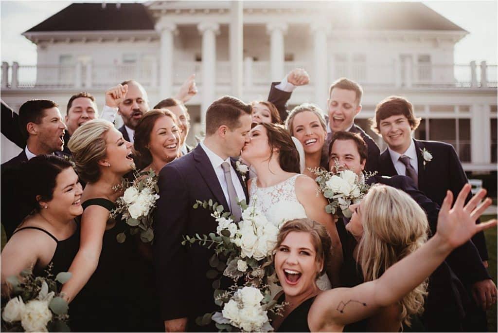 Wedding Party Surrounding Couple
