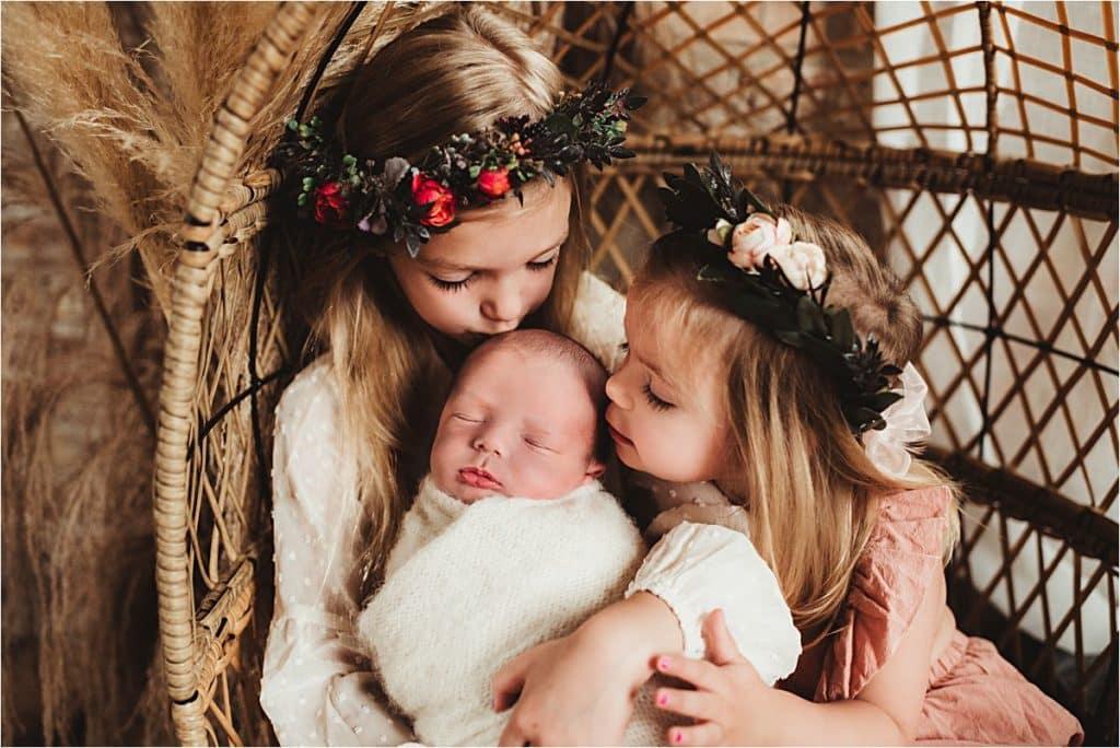 Summer Newborn Session Sisters Kissing Newborn