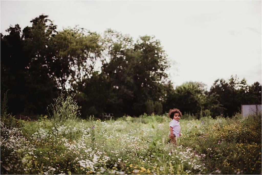 Urban Wildflower Family Session Little Boy Running in Field