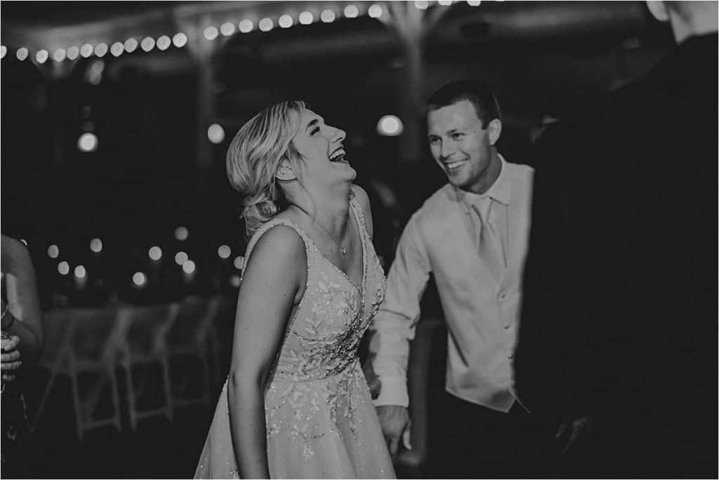 Candid Wedding Reception Image Bride Laughing