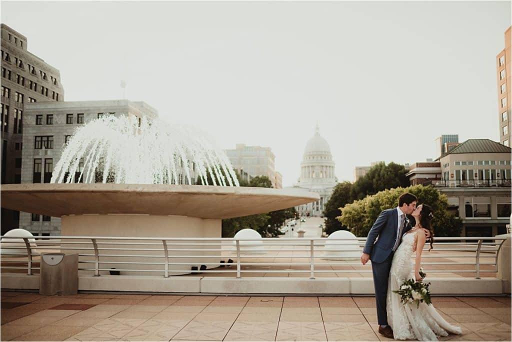Monona Terrace Summer Wedding Bride Groom Fountain